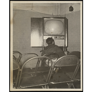 A Boy sitting in front of a television set
