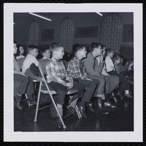 An audience of boys attend a Christmas party