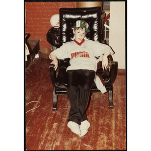 A Boy lounging in a chair at an open house event