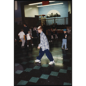 A Boy walking across the room during an open house