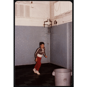 A boy stands behind a line at the Charlestown gymnasium