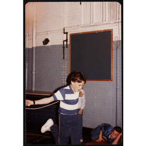 A boy holds a jump rope behind his back at the Charlestown gymnasium