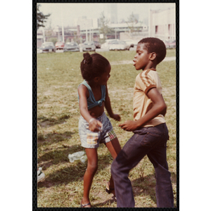 A boy and a girl dance on a field at the Tri-Club Field Day at the Roxbury Clubhouse