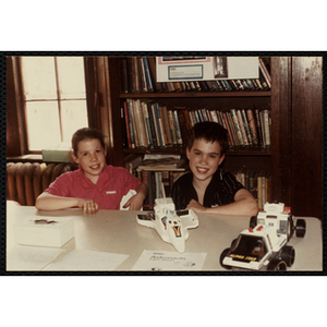A Boy and a girl sitting at a table with their project on NASA and astronauts