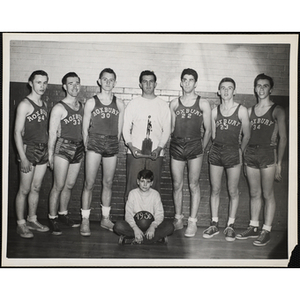 1949-1950 Roxbury Clubhouse basketball team posing with their trophy
