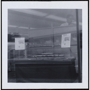 An architectural model of the new Clubhouse for the Roxbury Boys' Club on display in a storefront window