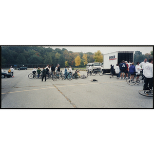 Adults and children congregate with their bikes in a parking lot for the Charlestown Bike Race