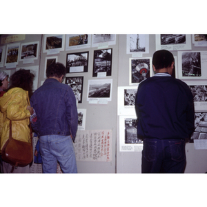 Attendees look at photographs of China on display at an unidentified exhibition