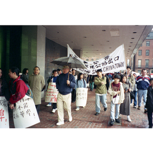 Activists marching against construction in Chinatown