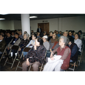 Audience listening to a lecture on immigrant rights