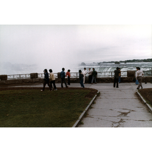 Chinese Progressive Association members stand on the observation deck at Niagara Falls