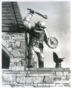 Warrior atop roof of castle