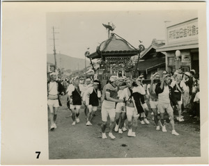 Men carrying a float in a matsuri procession