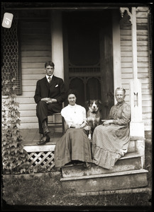 Young couple, dog, and elderly women seated on steps (Greenwich, Mass.)