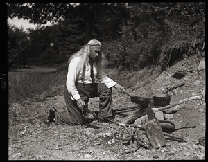 Albion L. Clough cooking at a campfire
