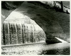 Waterfall under bridge