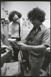 Abbie Hoffman and unidentified man looking at copy of Steal This Book, probably at Harvard Coop