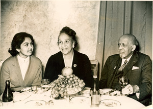 W. E. B. Du Bois, Shirley Graham Du Bois, and unidentified woman at dinner
