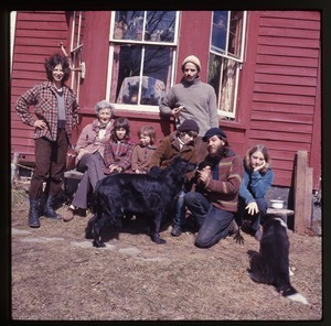 Nina Keller (far left) and her mother, Janice Frey (far right), and others, seated in front of the house at Montague Farm Commune with dogs