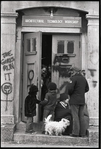 Women's occupation of the Architectural Technology Workshop, Harvard University: occupiers at door greeting children, dog