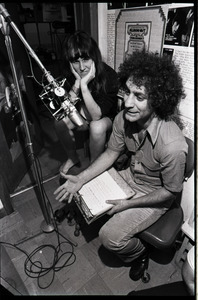 Abbie Hoffman at a microphone at radio station WBCN