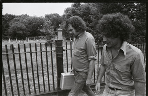 Abbie Hoffman and George Kimball walking past a cemetery (Garden Street side of Old Burying Ground)