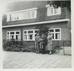 W. E. B. Du Bois, Shirley Graham Du Bois and an unidentified woman standing in front of a house