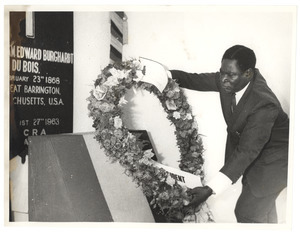 Unidentified minister of the Ghanaian government lays a wreath at the graveside of W. E. B. Du Bois