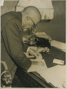 W. E. B. Du Bois working on his desk