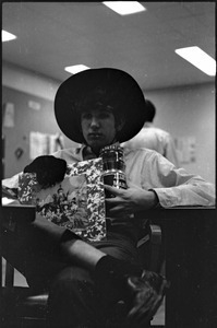 At the Boston University News Office: man holding copy of Rolling Stones', 'Their Satanic Majesties Request'