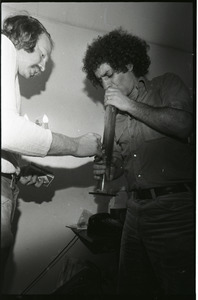 Abbie Hoffman: Hoffman (right) smoking marijuana in a bong at WBCN studio