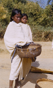 Young woman carrying a basket in the Ranchi district