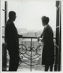 Shirley Graham Du Bois and an unidentified man standing on a balcony