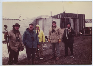 Birders outside a quonset hut