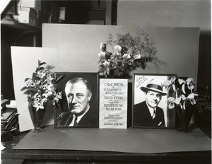 Orchids to President Roosevelt and Walter Winchell: portraits of Roosevelt and Winchell with orchid display (Dendrobium sp. and Cattleya labiata, l. to r.)