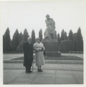 W. E. B. Du Bois and unidentified woman in front of a statue