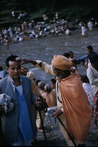 Priest blessing a pilgrim near the Baghmati river
