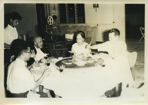 Shirley Graham Du Bois and W. E. B. Du Bois dining with three unidentified individuals