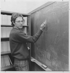 Joseph H. Taylor, UMass Amherst Professor of Physics and Astronomy, standing at a blackboard