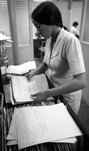 Office worker filing papers