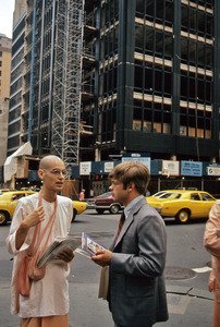 Hare Krishna monk with a businessman