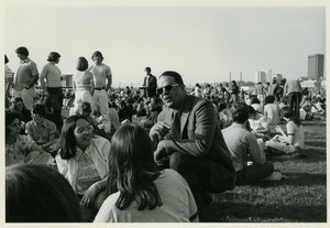 Randolph W. Bromery conversing with students outside at student picnic