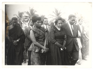 Unidentified minister of the Ghanaian government escorting Shirley Graham Du Bois at the state funeral for W. E. B. Du Bois