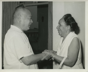 Shirley Graham Du Bois holding hands with Chen Yi