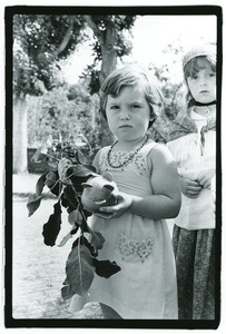 Child with coins in France