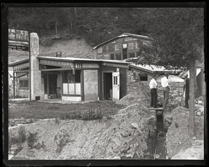 Dug out Dan (Dana Smith): exterior view of Dan's dugout home, the No. 9 Lonely Hearts Club, with Dan at far right