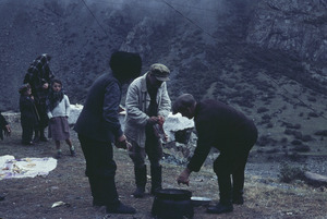 Men preparing to cook sheep on the Georgian Military Highway