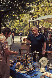 Man selling in an outdoor market