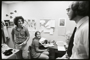 Abbie Hoffman with Steal This Book, talking to unidentified man