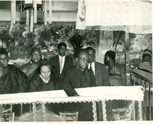 Shirley Graham Du Bois and Kwame Nkrumah beside open casket during state funeral for W. E. B. Du Bois
